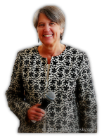 photo of Christine A. Padesky, PhD holding microphone